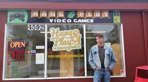 Adrian McBurney in front of his game shop, Hang & Play (photo provided).