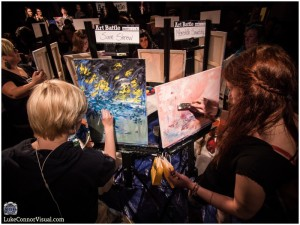 Artists hard at work during a previous Art Battle event (photo provided).
