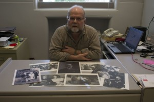 Camosun's Andy Bryce with pictures of his great-grandfather (photo by Jill Westby/Nexus).