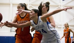 Rachael Bakker of the Camosun Chargers women's basketball team hard at work during a game last season (photo by Kevin Light).