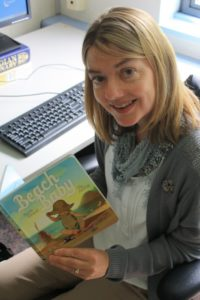 Camosun's Laurie Elmquist holding her recently published book (photo by Adam Marsh/Nexus).